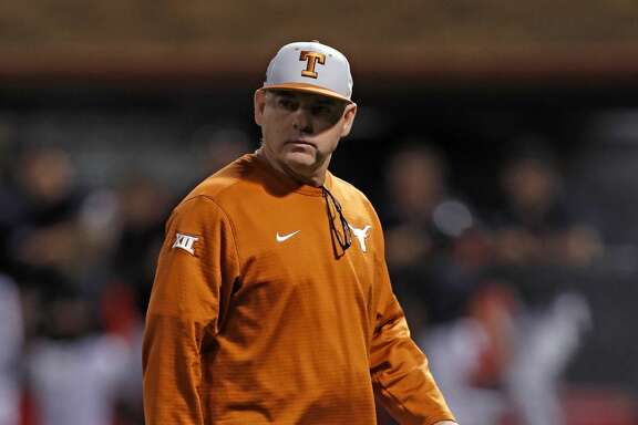 Texas coach David Pierce walks off the field during the team's college baseball game against Texas Tech on Friday, May 4, 2018, in Lubbock, Texas. (Brad Tollefson/Lubbock Avalanche-Journal via AP)