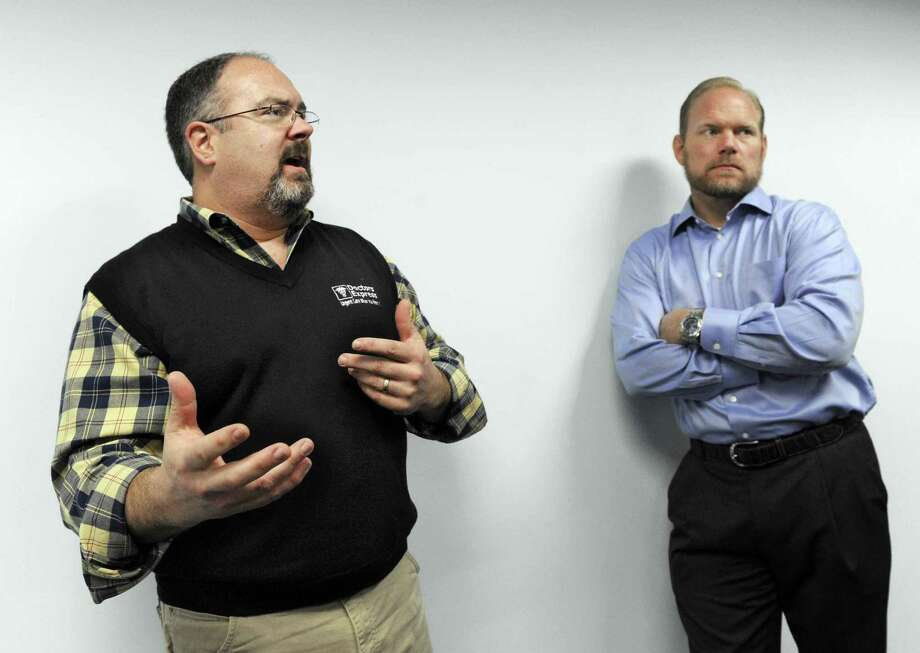 Tom Kelly, left, and Ron Krippner, owners of AFC urgent care centers in Connecticut, talk about opening their location on Mill Plain Road in Danbury, Conn., in this 2014 file photo. Photo: Carol Kaliff / Carol Kaliff / The News-Times
