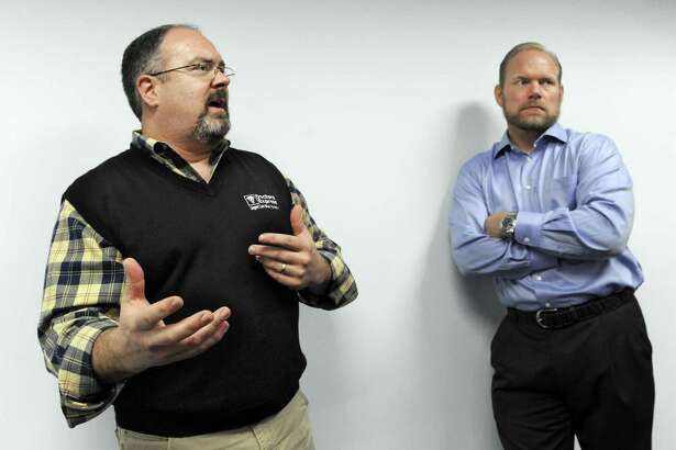 Tom Kelly, left, and Ron Krippner, owners of AFC urgent care centers in Connecticut, talk about opening their location on Mill Plain Road in Danbury, Conn., in this 2014 file photo.