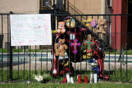 A memorial for a six-year-old boy, who drowned at an Avalon Bay Apartments swimming pool Wednesday night, can be seen on the pool's fence Thursday, May 24, 2018, in Baytown, Texas.