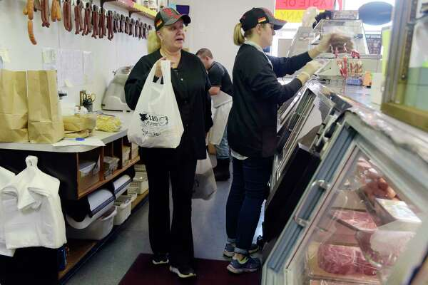 Kathy Eggelhoefer, left, wife of Glen Eggelhoefer, and Carolyn Gifford serve customers from behind the counter on Wednesday, May 23, 2018, in Albany, N.Y.   (Paul Buckowski/Times Union)