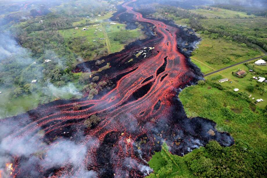 Ash plume rises from forest following a massive volcano eruption on Kilauea volcano in Hawaii, United States on May 22, 2018. Lava is spewing more than 60 metres into the air and spread around 36,000 square metres. Photo: Anadolu Agency/Getty Images / 2018 Anadolu Agency