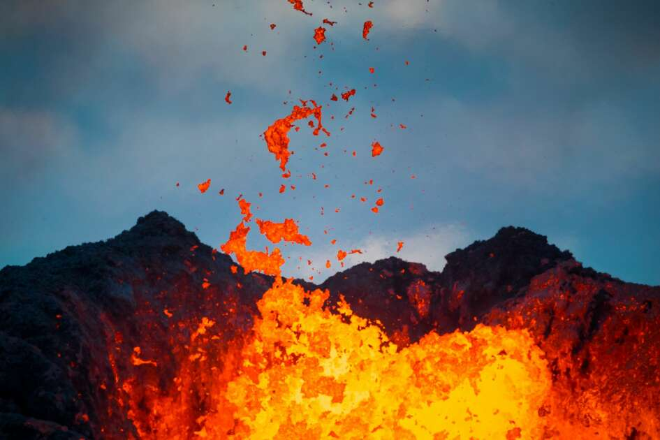 PAHOA, HI - MAY 22:  Lava flows from a Fissure in the aftermath of eruptions from the Kilauea volcano on Hawaii's Big Island, on May 22, 2018 in Pahoa, Hawaii. The U.S. Geological Survey said a recent lowering of the lava lake at the volcano's Halemaumau crater has raised the potential for explosive eruptions at the volcano. Authorities have confirmed a 16th lava fissure opened in the vicinity of Pahoa. (Photo by Andrew Richard Hara/Ena Media Hawaii/Getty Images)
