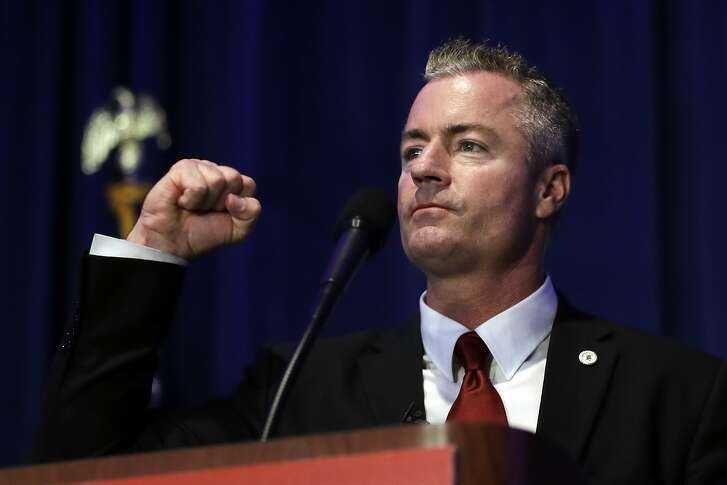 FILE - In this May 5, 2018 file photo, California gubernatorial candidate Travis Allen, a Republican Assemblyman from Huntington Beach, Calif., speaks during the California Republican Party convention in San Diego. In the race for California governor, Republicans Allen and John Cox have shunned the center and are running to the right in a bloody fight for a segment of the electorate that loves President Donald Trump and loathes the Democrats who have proudly committed to being his foil. Polls show one of them could very well finish second in the June 5 primary, earning a spot in the November general election. (AP Photo/Gregory Bull, File)