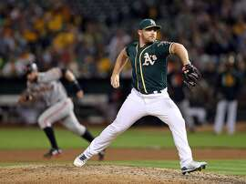 Oakland Athletics' Liam Hendriks pitches against San Francisco Giants in 7th inning during MLB game at Oakland Coliseum in Oakland, Calif. on Monday, July 31, 2017.
