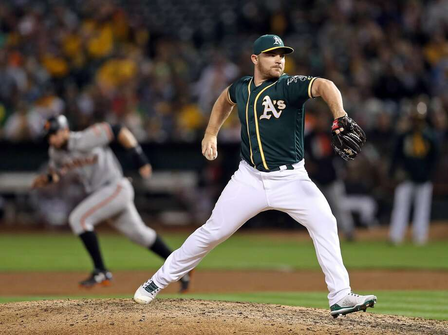 Oakland Athletics' Liam Hendriks pitches against San Francisco Giants in 7th inning during MLB game at Oakland Coliseum in Oakland, Calif. on Monday, July 31, 2017. Photo: Scott Strazzante / The Chronicle