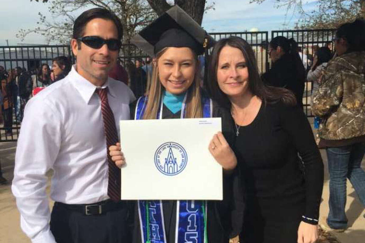 Hailey Reyes poses for a photo with her parents after graduating from Our Lady of the Lake University with a bachelor's degree in psychology.