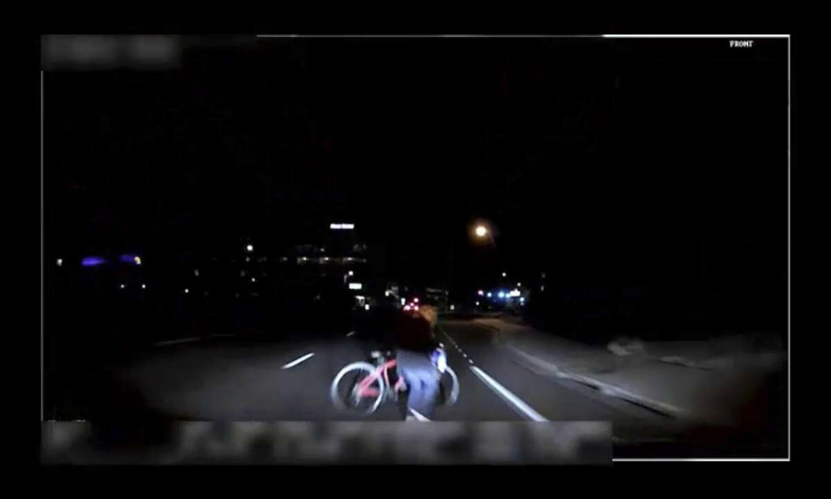 FILE- This file image made from video March 18, 2018, of a mounted camera provided by the Tempe Police Department shows an exterior view moments before an Uber SUV hit a woman in Tempe, Ariz. In a preliminary report on the crash released Thursday, May 24, federal investigators said the autonomous Uber SUV that struck and killed an Arizona pedestrian in March spotted the woman about six seconds before hitting her, but didn�t stop automatically because emergency braking was disabled. (Tempe Police Department via AP, File)