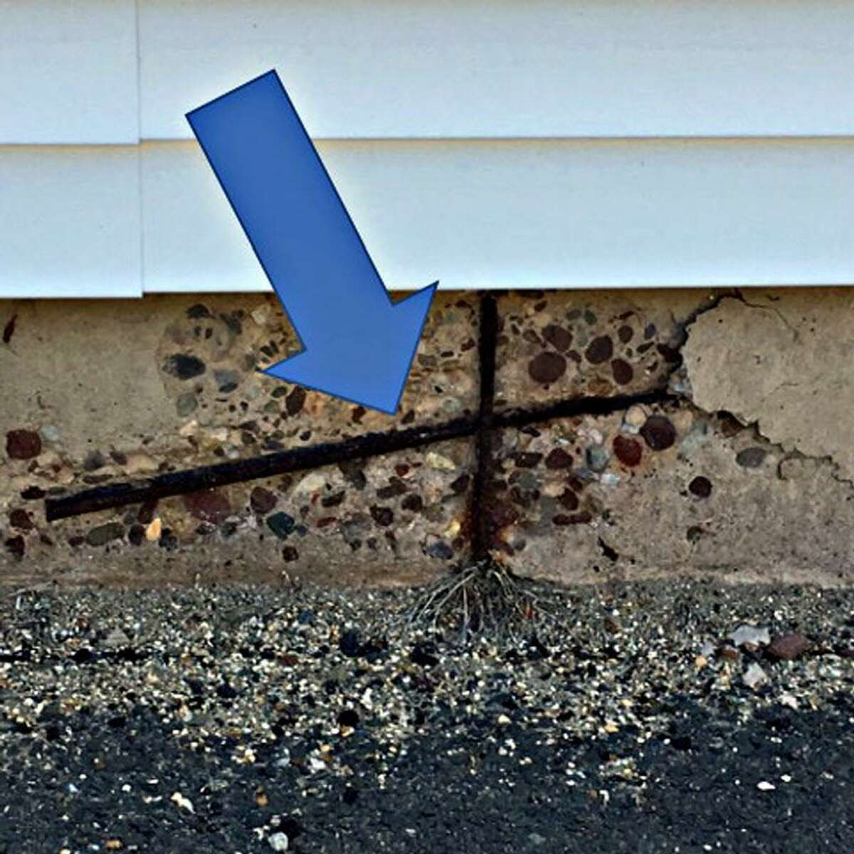 Issues at East Hampton Town Hall include corroded pipes, makeshift water mitigation system, cracks in foundation, deteriorating concrete around window wells, exposed rebar and rotted sill plates.