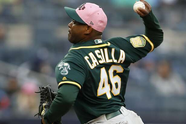 Oakland Athletics relief pitcher Santiago Casilla (46) pitches during the seventh inning of a baseball game against the New York Yankees in New York, Sunday, May 13, 2018. (AP Photo/Kathy Willens)