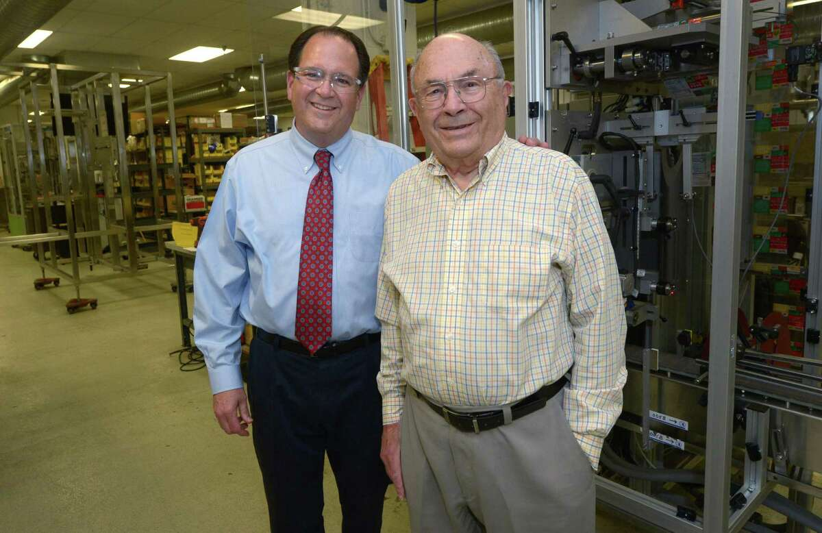Neal and Anatole Konstantin, President and Founder of PDC International, tour their 8 Sheehan Road plant Thursday, May 17, 2018, in Norwalk, Conn. The adhesive machine maker reaches its 50th anniversary this year.