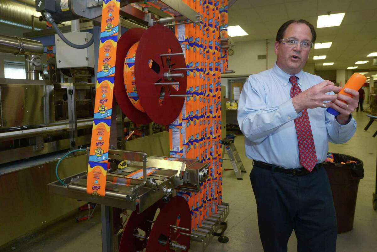 Neal Konstantin, President of PDC International, tours his 8 Sheehan Road plant Thursday, May 17, 2018, in Norwalk, Conn. The adhesive machine maker reaches its 50th anniversary this year.