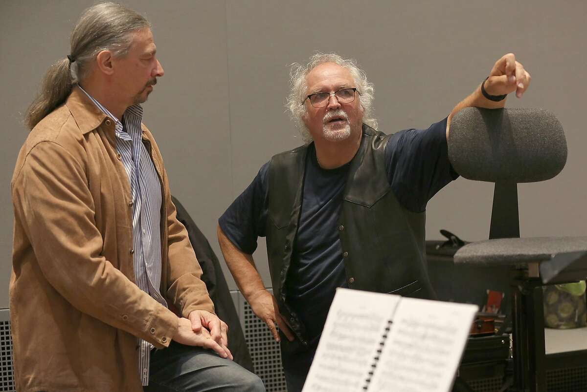Daniel Brenna (left) talks with conductor Donald Runnicles (right) during a break at rehearsal of Richard Wagner's 'The Ring' at the Veterans Memorial building on Wednesday, May 23, 2018 in San Francisco, Calif.
