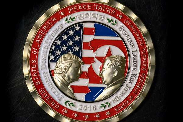 (FILES) In this file photo taken on May 21, 2018 A coin for the upcoming US-North Korea summit is seen in Washington, DC. US President Donald Trump sent a letter to North Korean leader Kim Jong Un on May 24, 2018 announcing their planned June 12 landmark summit in Singapore would not take place. / AFP PHOTO / STRSTR/AFP/Getty Images