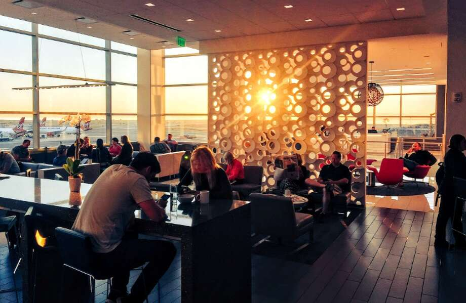 Watching the sun and the planes from a pretty perch at Delta's exceptional Sky Club at SFO - part of the package with the Delta Reserve credit card Photo: Chris McGinnis