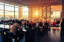 Watching the sun and the planes from a pretty perch at Delta's exceptional Sky Club at SFO (Chris McGinnis)