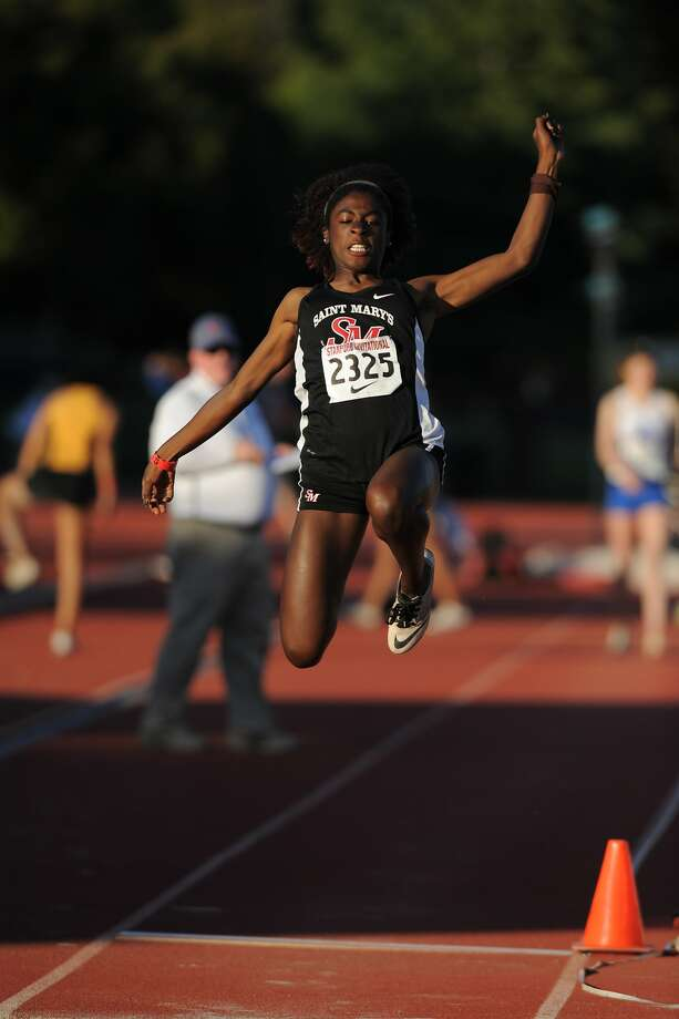 St. Mary's-Berkeley's Kali Hatcher -- here competing in the triple jump at the Stanford Invitational in March -- is a track and field triple threat. The state runner-up in the triple jump last year, she could win state titles in the triple and and long jumps and is also the area's best 300-meter hurdler. Photo: Eric Taylor / 1ststring