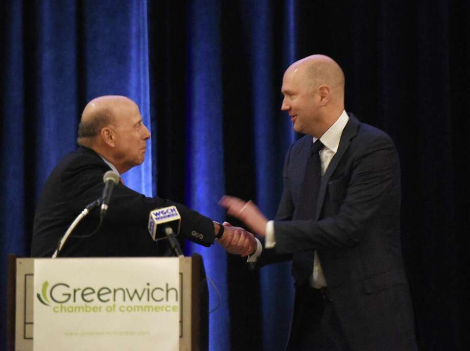 Richards owner Scott Mitchell accepts his award in corporate leadership from last year's winner, Richard Koppelman, of Miller Motorcars, at the 2018 Greenwich Chamber of Commerce Awards Luncheon at the Hyatt Regency in Greenwich on Thursday. Photo: Tyler Sizemore / Hearst Connecticut Media / Greenwich Time