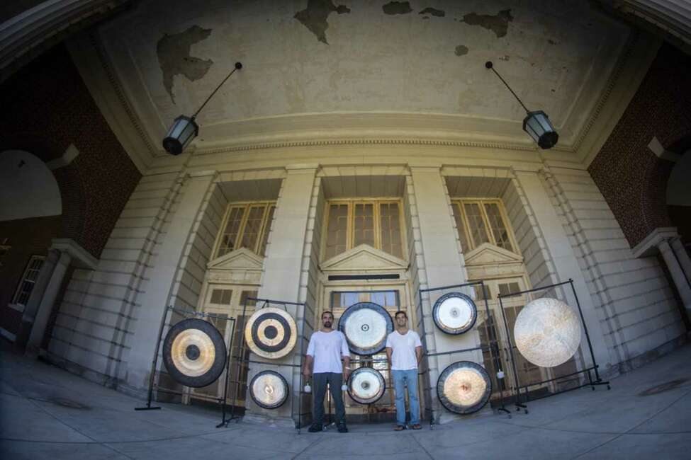A similar photo including Jim and Nick Pavoldi with their gongs before an event at the Roosevelt II baths in Saratoga Springs