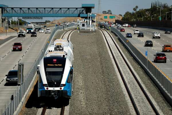 A new diesel-powered train approaches the Antioch Station during a test run of a new BART extension that runs from the Pittsburg-Bay Point station to Hillcrest Avenue in Antioch, Calif., on Wednesday, May 23, 2018. The new people moving line runs down the middle of Highway 4 for that length