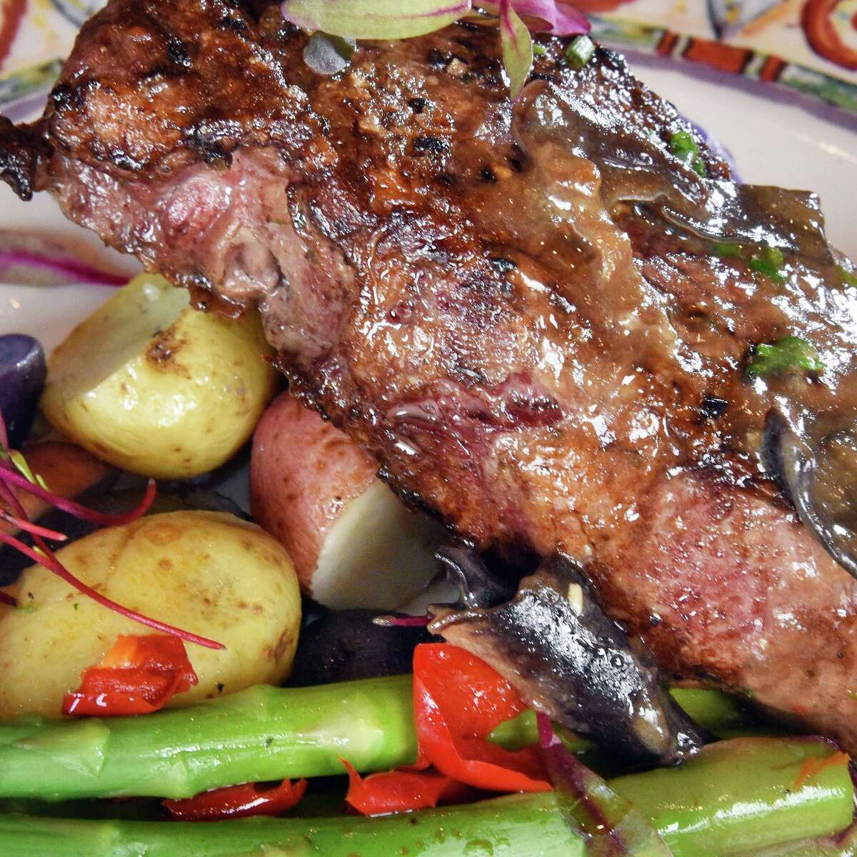NY strip steak with exotic mushrooms at Illusive Restaurant Thursday May 17, 2018 in Rensselaer, NY. (John Carl D'Annibale/Times Union)