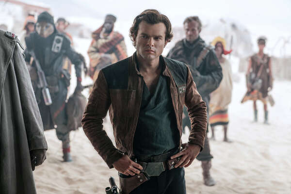 "In this image released by Lucasfilm, Alden Ehrenreich appears in a scene from ""Solo: A Star Wars Story."" (Jonathan Olley/Lucasfilm via AP)"