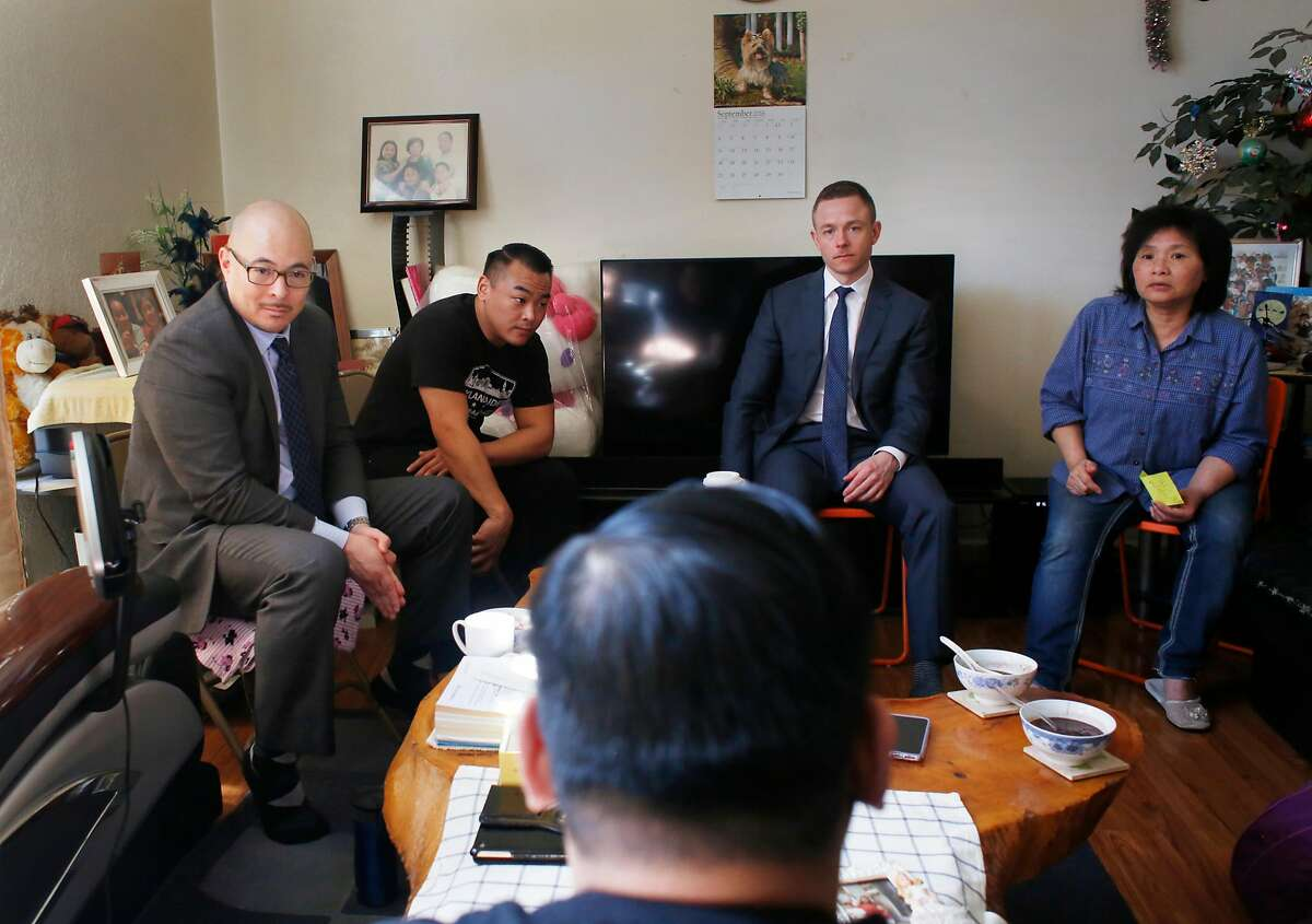 John Hamasaki (back l to r), attorney for Lam family; Sunny Lam, brother of Cecelia Lam; Nick Casper, attorney for Lam family; and Shut Fan Lam, mother of Cecelia Lam, listen to Eddie Lam (foreground center), brother of Cecelia Lam, speak as they family meets to talk with attorneys in the Lam family home during an interview on Sunday, March 12, 2017 in Oakland, Calif. Cecelia Lam was shot and killed by her partner during a domestic violence incident in San Francisco in October of 2014,