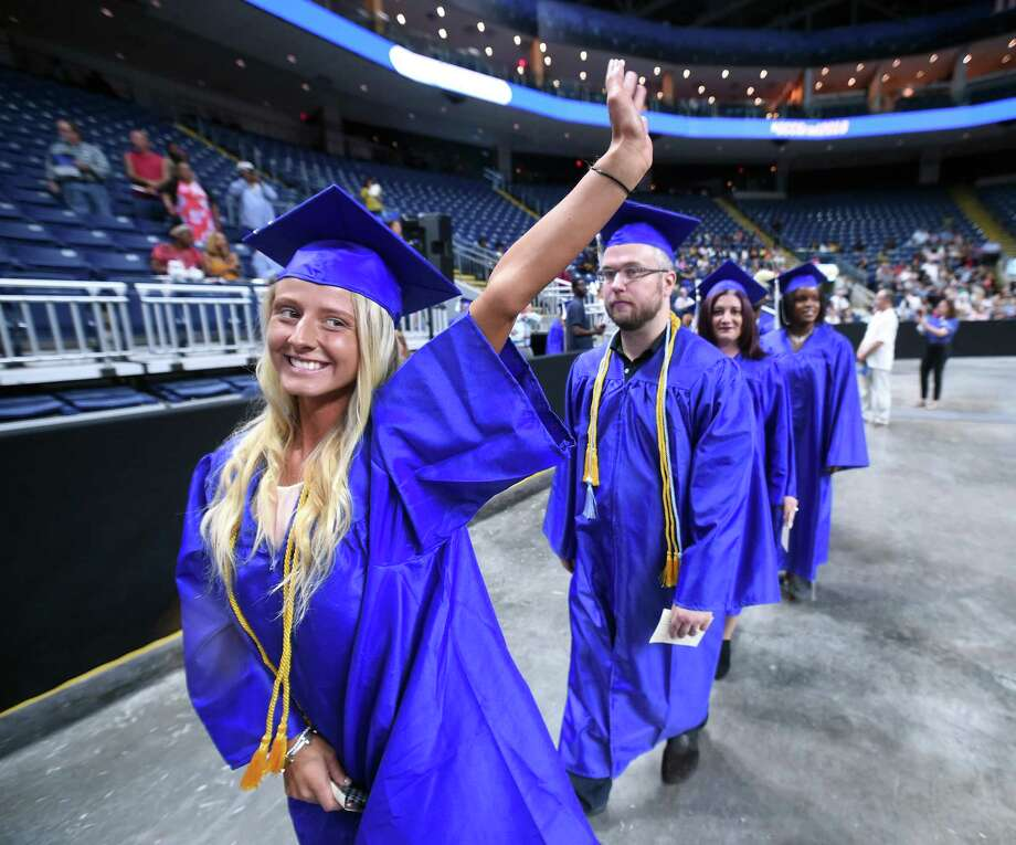 Kayleigh Roy of Wallingford waves to family as she enters Webster Bank Arena for Gateway Community College's commencement exercises Friday. Photo: Arnold Gold / Hearst Connecticut Media / New Haven Register