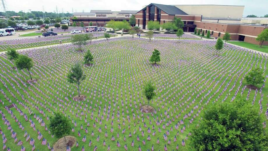 In southeast Houston, Sagemont Church's Memorial Day celebration includes more than 38,000 flags to remember Texans who lost their lives in battle. Photo: Photo Courtesy Of Chuck Schneider, Executive Pastor At Sagemont Church.