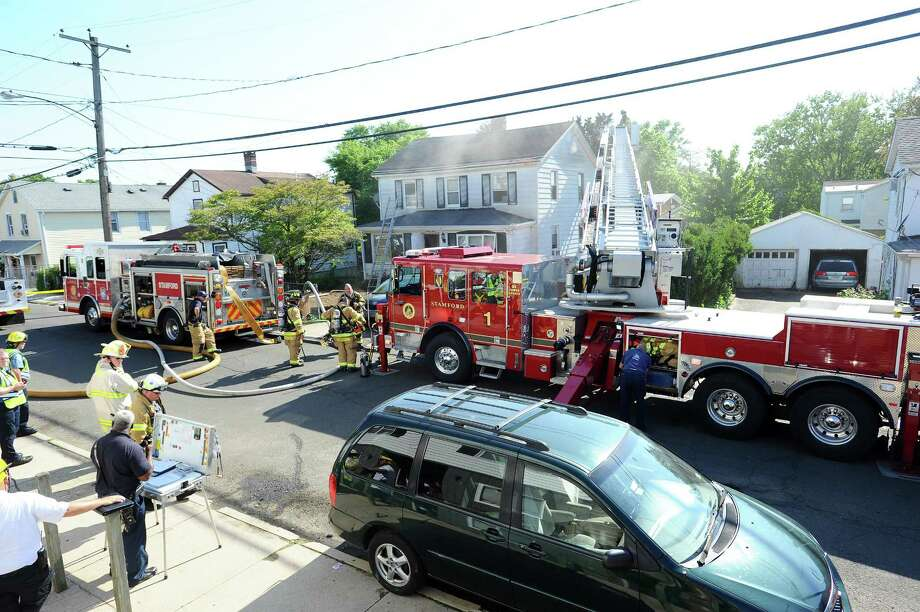 Fire fighters battle a fire on Soundview Ave. in Stamford, Conn. on Thursday, May 24, 2018. Photo: Michael Cummo / Hearst Connecticut Media / Stamford Advocate