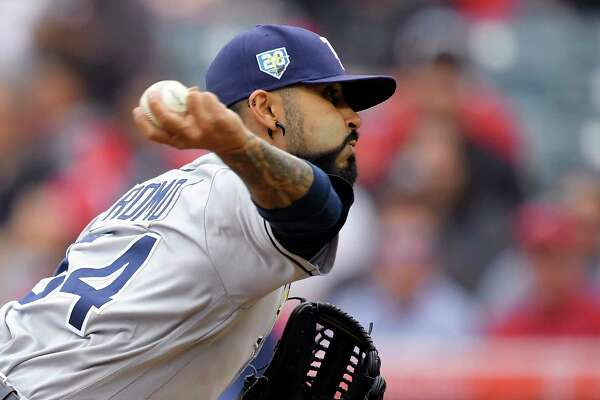 Tampa Bay Rays starting pitcher Sergio Romo throws to the plate during the first inning of a baseball game against the Los Angeles Angels, Sunday, May 20, 2018, in Anaheim, Calif. (AP Photo/Mark J. Terrill)