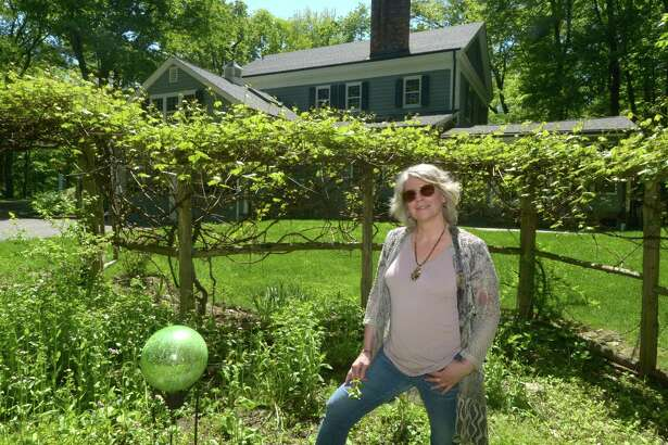 Karen Kissling is looking to sell her Cornell built, Federal style, the 2972 square foot Center Hall Colonial Wednesday, May 23, 2018, in Wilton, Conn.The home is only steps away from the United States National Park Weir Farm.