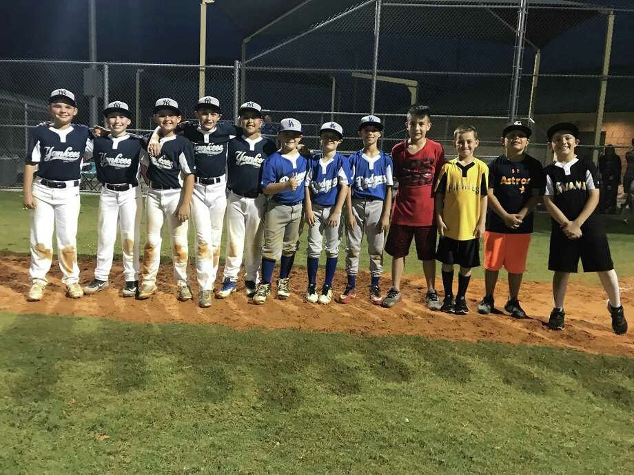 The newly-named Deer Park Mustang All-Stars line up along the first-base line after the group was selected to represent the city in all-star competition this summer. Photo: Robert Avery