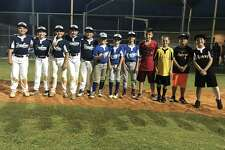 The newly-named Deer Park Mustang All-Stars line up along the first-base line after the group was selected to represent the city in all-star competition this summer.