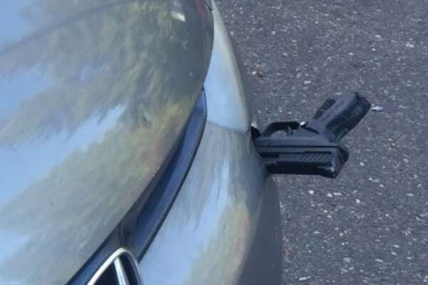A gun was found lodged in a car that was driving on I-5 near Lakewood, Wash.