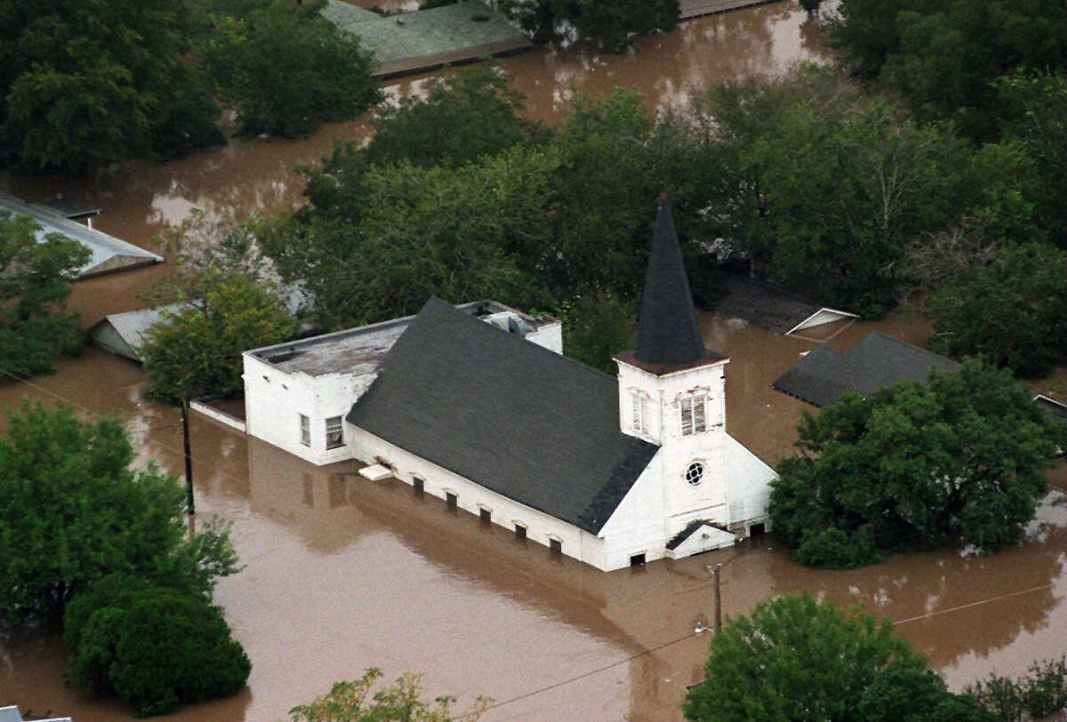 A flooded church in Cuero is surrounded by water from the Guadalupe River Tuesday Oct. 20, 1998.