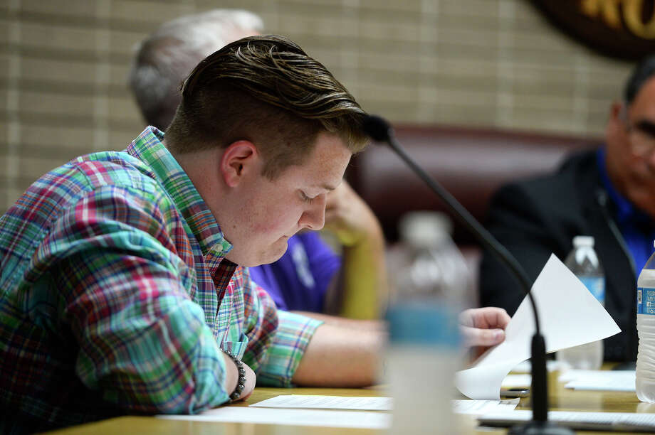 Groves Councilman Cross Coburn reviews an agenda during the city council meeting on Monday, May 14. It was the council's first meeting since a citizen started a recall petition against Coburn after nude photos were leaked.  Photo taken Monday 5/14/18 Ryan Pelham/The Enterprise Photo: Ryan Pelham / ©2018 The Beaumont Enterprise/Ryan Pelham