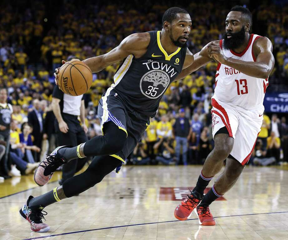 Golden State Warriors forward Kevin Durant (35) works against Houston Rockets guard James Harden (13) during the second half of Game 4 of the Western Conference Finals at Oracle Arena Tuesday, May 22, 2018 in Oakland. (Michael Ciaglo / Houston Chronicle) Photo: Michael Ciaglo, Houston Chronicle / Houston Chronicle / Michael Ciaglo