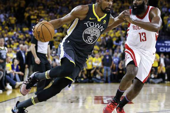 Golden State Warriors forward Kevin Durant (35) works against Houston Rockets guard James Harden (13) during the second half of Game 4 of the Western Conference Finals at Oracle Arena Tuesday, May 22, 2018 in Oakland. (Michael Ciaglo / Houston Chronicle)