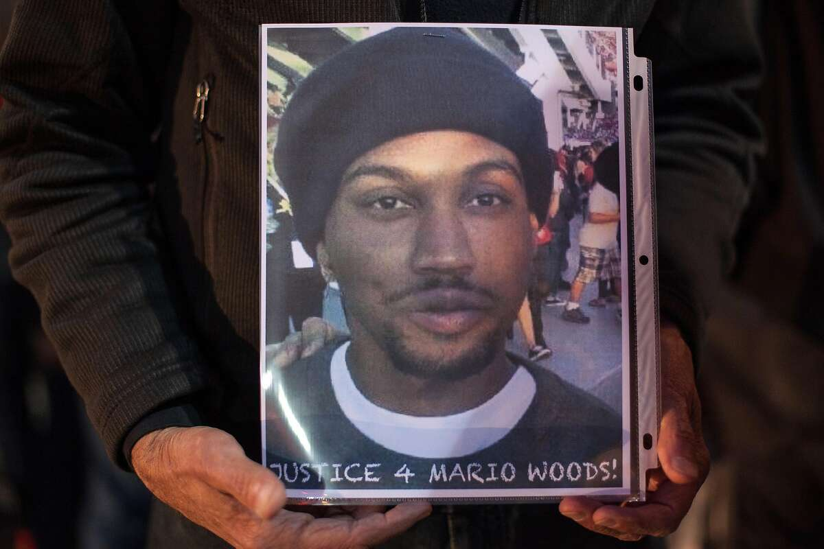 A man mourns the death of Mario Wood outside San Francisco City Hall, Wednesday, Dec. 9, 2015, in San Francisco, Calif. The S.F. Police Commission met inside City Hall and talked about the possibility of equipping police officers with Tasers following the fatal shooting of Mario Woods. It's a proposal that was turned down twice by the commission in recent years. Woods' case has brought the proposal back. Woods was shot and killed by police officers after police say Woods was armed with a knife and walked toward officers.