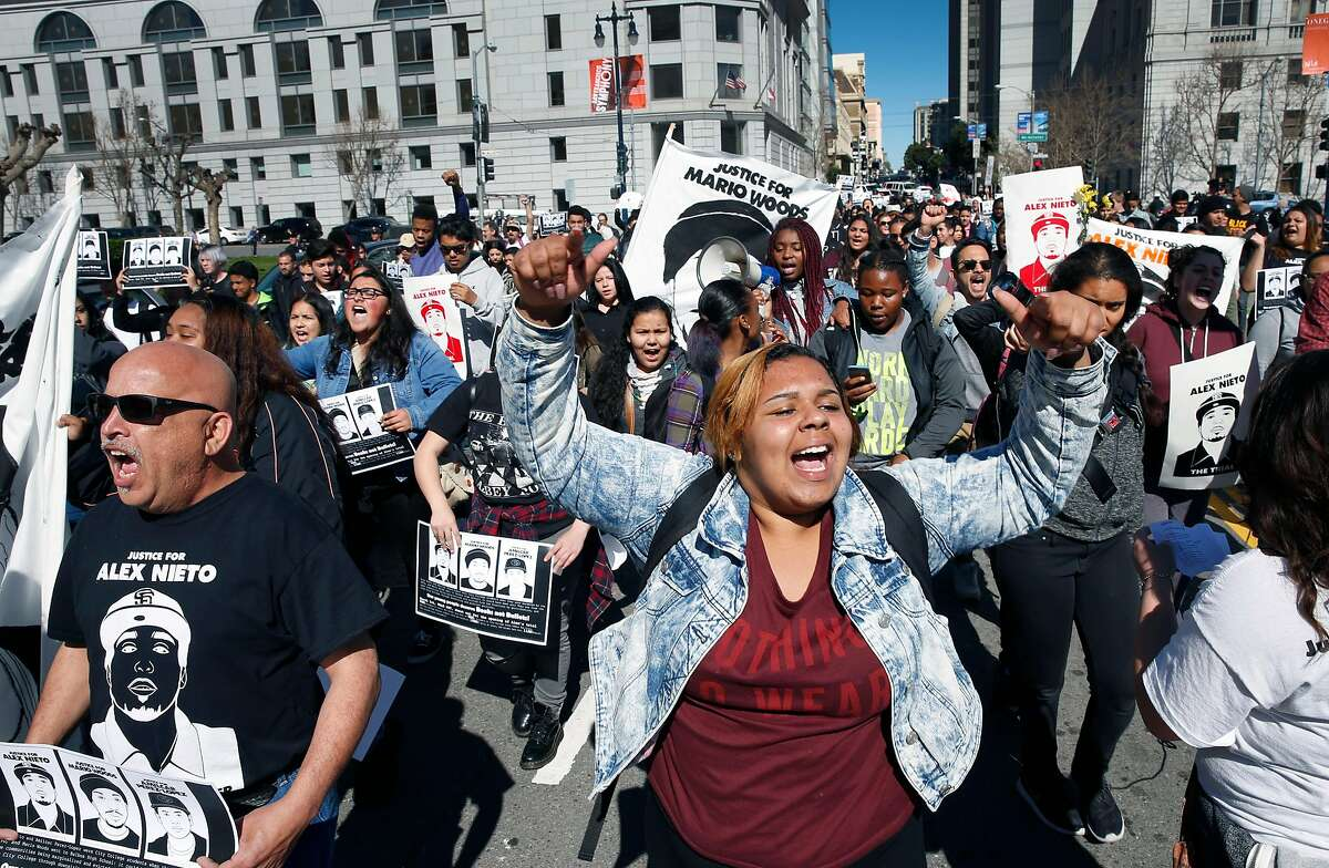 Faleula Linu (right) leads marchers demanding justice for Alex Nieto from the Phillip Burton Federal Building to City Hall in San Francisco, Calif. on Tuesday, March 1, 2016. Jury selection and opening arguments were scheduled to get underway Tuesday in a federal civil rights trial against four police officers who shot and killed Alex Nieto in Bernal Heights Park nearly two years ago.