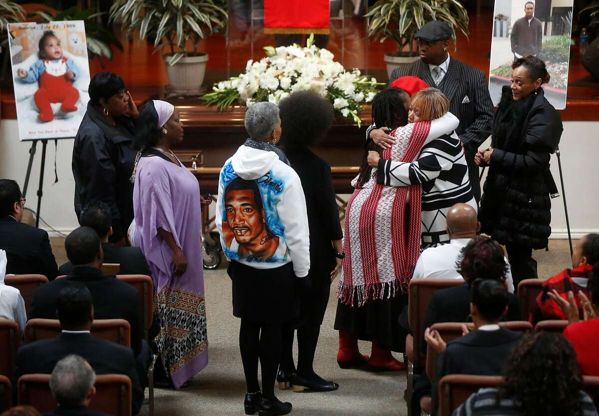 Mothers who have also lost their sons line up to hug Gwen Woods as she mourns her late son Mario Woods during his funeral service at Cornerstone Missionary Baptist Church Dec. 17, 2015 in San Francisco, Calif. Mario Woods was fatally shot by San Francisco police in early December.