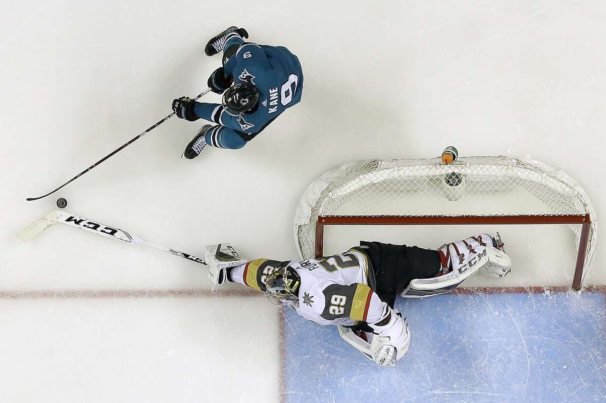 San Jose Sharks left wing Evander Kane (9) skates as Vegas Golden Knights goaltender Marc-Andre Fleury (29) reaches for the puck during Game 4 of an NHL hockey second-round playoff series in San Jose, Calif., Wednesday, May 2, 2018. (AP Photo/Jeff Chiu)