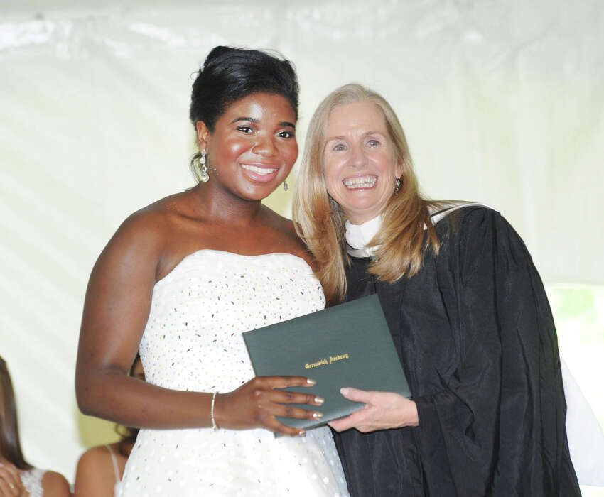 Ese Bowry, left, receives her Greenwich Academy diploma from Greenwich Academy Head of School Molly King during the commencement at the school in Greenwich, Conn., Thursday, May 24, 2018.