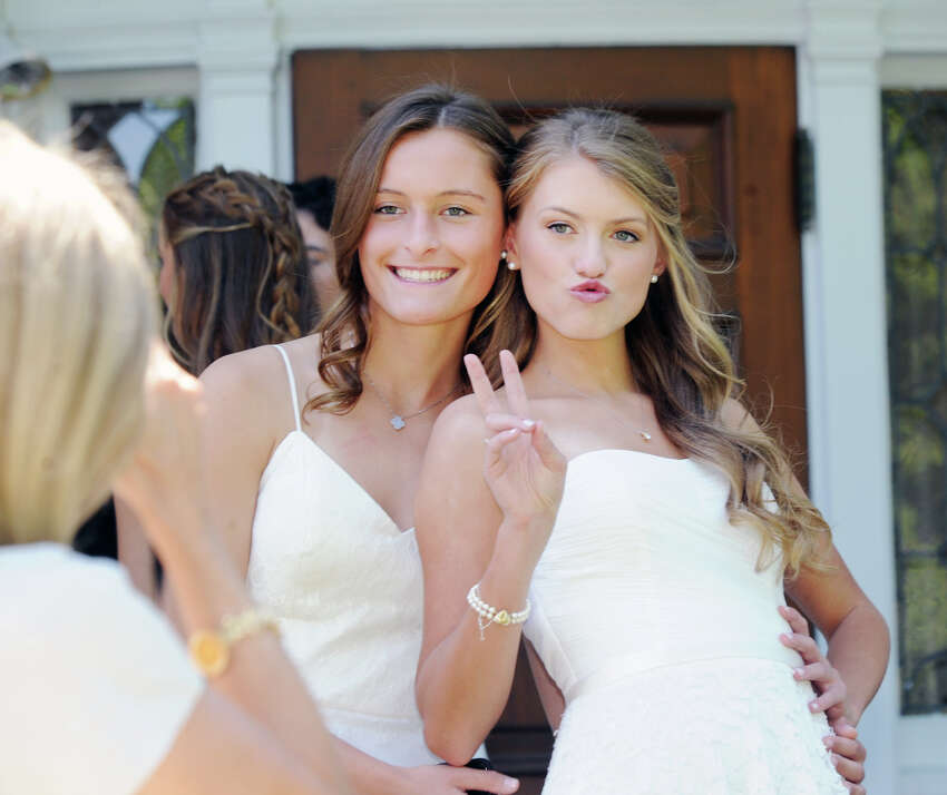 Greenwich Academy graduating seniors Courtney DeNaut, 18, left, and Christina Lawrence, 18, both of Greenwich, pose for photos during the Greenwich Academy commencement at the school in Greenwich, Conn., Thursday, May 24, 2018.