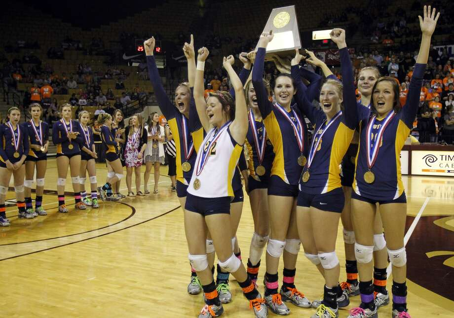 Poth players celebrate after defeating Nocona to win the class 2A state volleyball final at Strahan Coliseum at Texas State University on Saturday, Nov. 19, 2011. MICHAEL MILLER / mmiller@express-news.net Photo: MICHAEL MILLER, STAFF / SAN ANTONIO EXPRESS-NEWS / mmiller@express-news.net