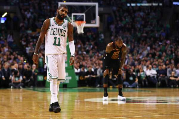 BOSTON, MA - JANUARY 3: LeBron James #23 of the Cleveland Cavaliers and Kyrie Irving #11 of the Boston Celtics look on during the second half at TD Garden on January 3, 2018 in Boston, Massachusetts. (Photo by Maddie Meyer/Getty Images)