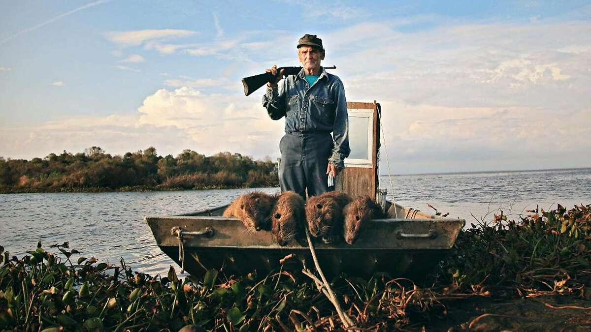 Fisherman and hunter Thomas Gonzalez with a bounty of nutria in