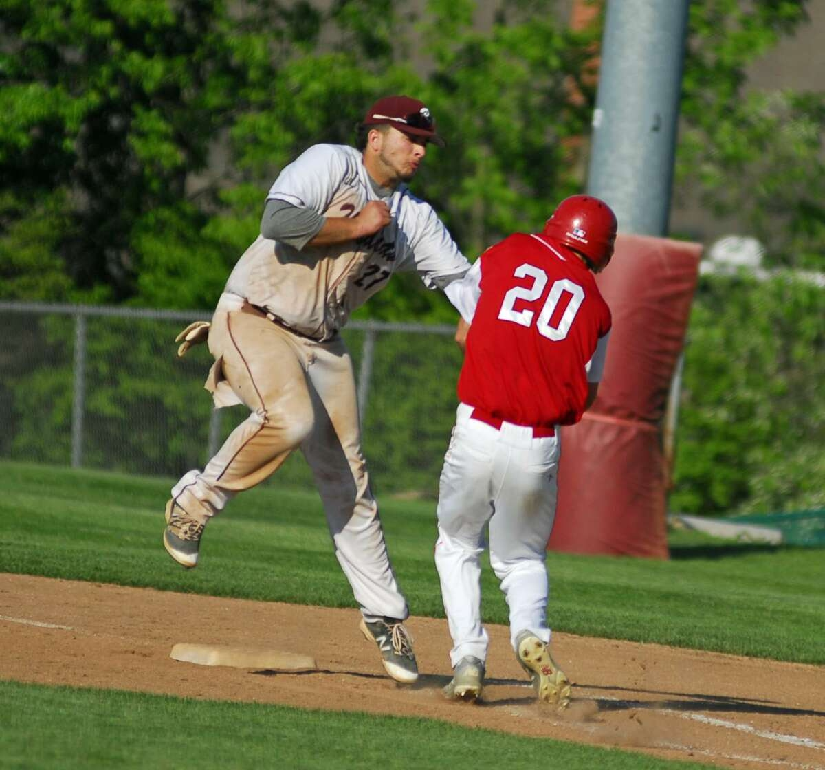 Bethel's Jaxon Millet, left, tags a Masuk runner during their SWC semifinal game on Thursday.
