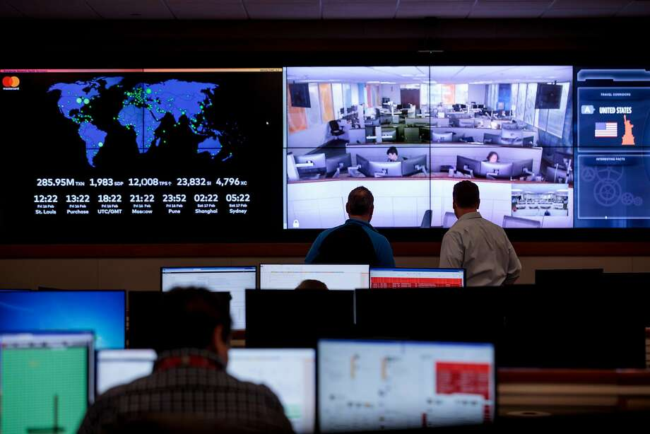 At Mastercard's fusion center in O'Fallon, Mo., company experts in fraud detection, network engineering and forensic analysis work alongside employees from the legal and customer service departments. Photo: Whitney Curtis / New York Times